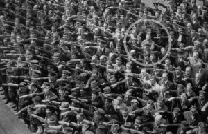 man refusing to do Nazi salute. Conformity