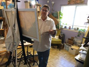 David Borden painting in his studio