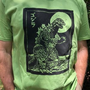 black Godzilla on green t-shirt