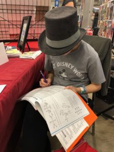 Ruby doing Chemistry homework in our booth in her top hat.